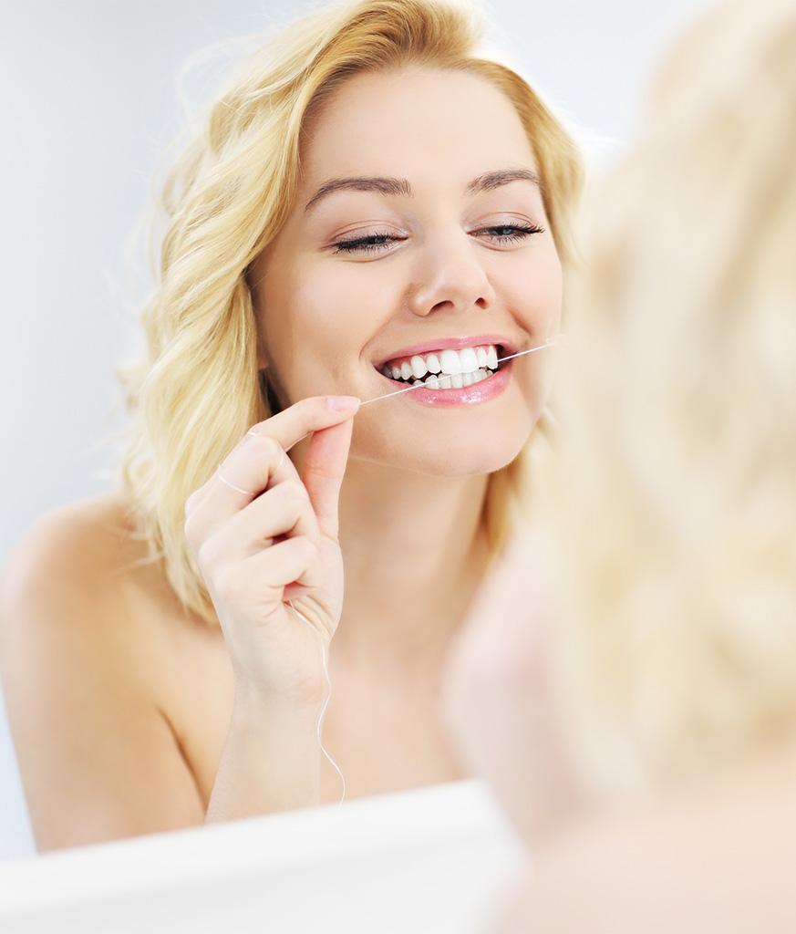 Zahnseide 873x1024 Zahnerhaltung Haeusliche Zahnpflege Zahnarzt Köln